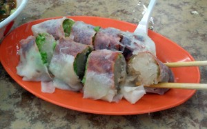Another Popiah. The difference is that, they have poured a scoop of gravy on it.